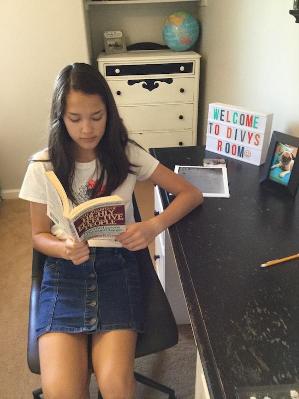 Girl reading 7 Habits books
