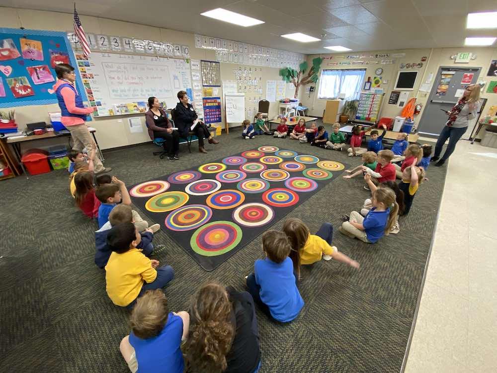 kindergarten class sitting on floor