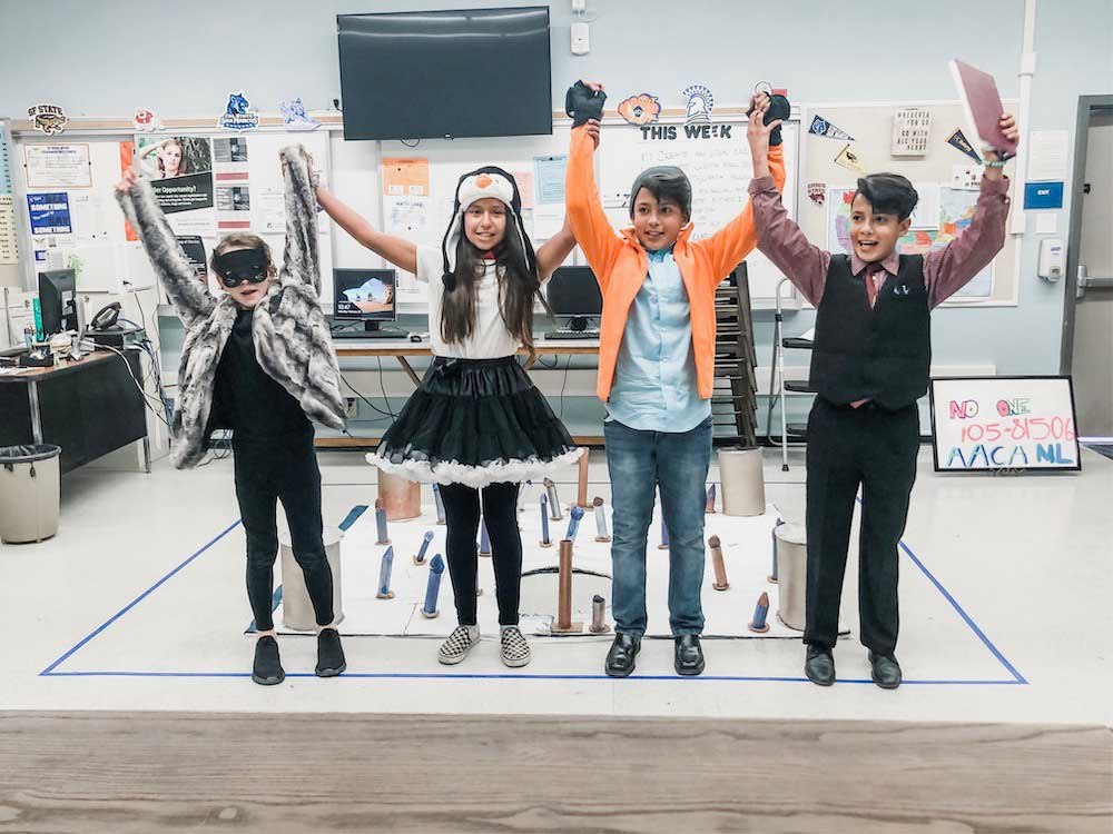 students with hands in air