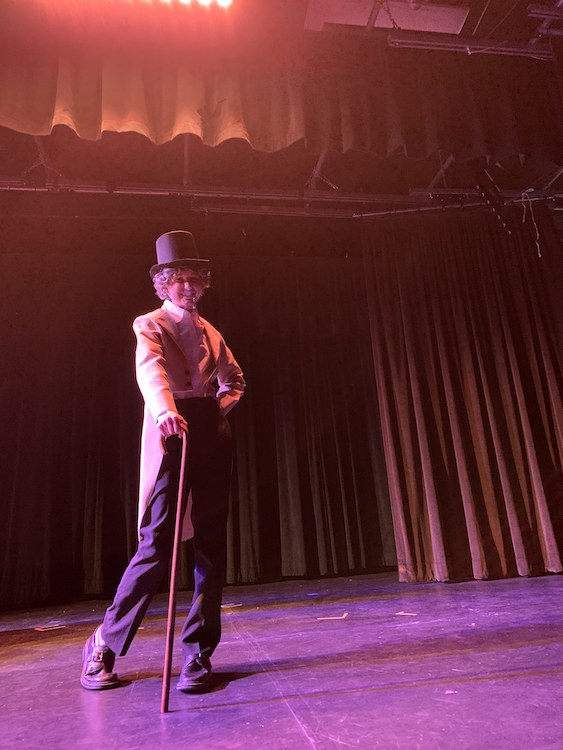 Almond Acres Charter Academy student on a stage in character for a movie created with Paso Robles Youth Arts Center
