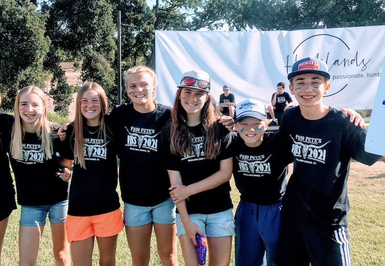 Six Almond Acres middles school students volunteering together